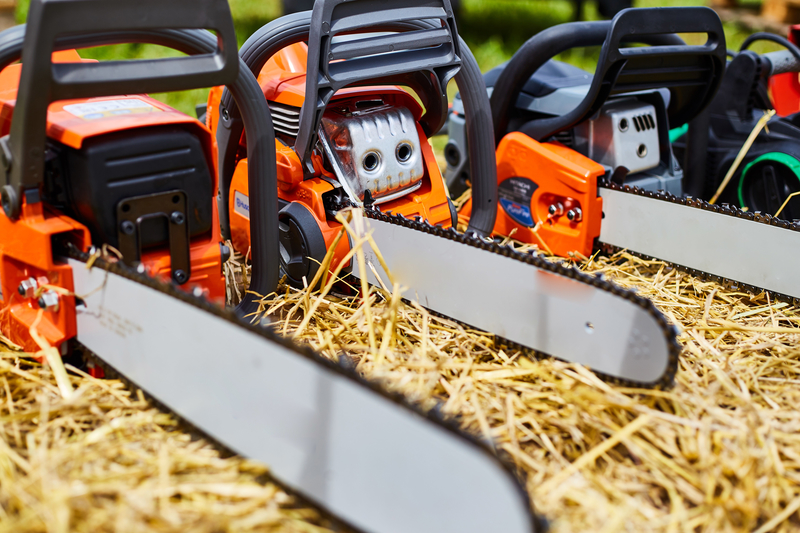 Chainsaws on top of a hay bail
