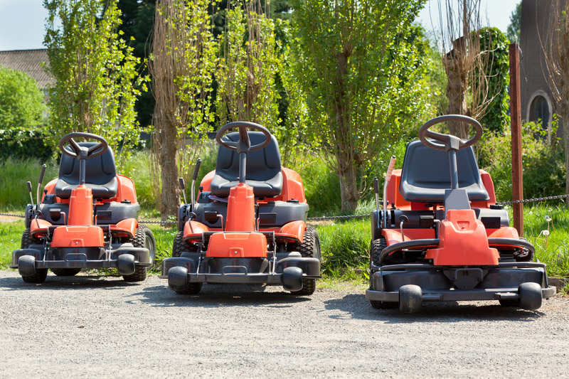 Three New Red Lawnmowers