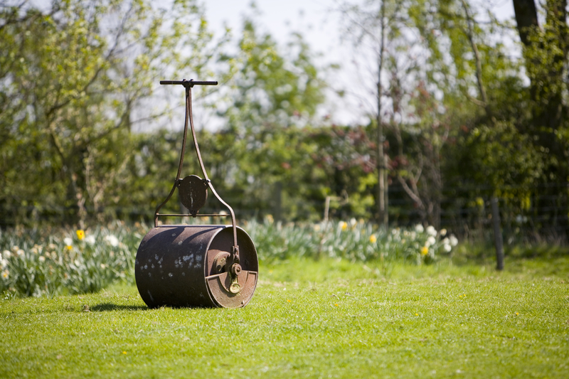 still life image garden lawn roller with at lot of hard work you to can have a nice flat lawn!
